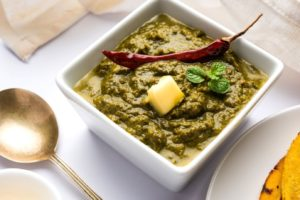 Made with spinach, mustard leaves and ground spices, this Punjabi classic dish, Sarson ka saag, is a winter favourite. Equal parts healthy and scrumptious, this makes for a perfect main course, served with some Indian bread.